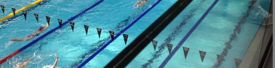 Swim etiquette with swimmers swimming correctly in a pool